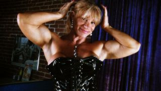 Kathy Conners flexing her biceps.