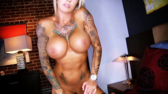 Busty fitness model Duchess Dani showing her tattoos