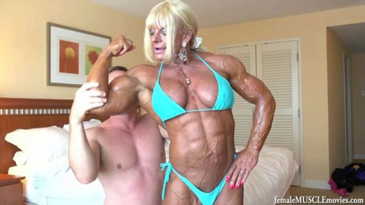 maryse manios flexing for a guy