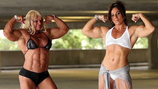 Annie Rivieccio and Maryse Manios flexing biceps