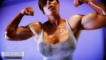 Goddess Rapture flexing her huge biceps