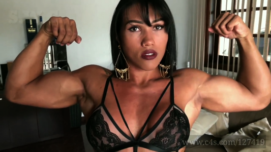 Brazilian Female Bodybuilder Alessandra Alvez flexing biceps