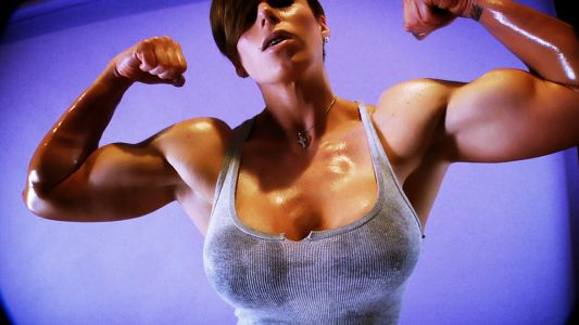 Goddess Rapture flexing her big biceps.