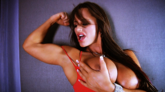 busty muscle MILF flexing biceps