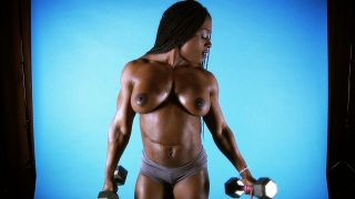 Muscular ebony muscle girl Ashley Starr.
