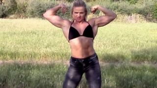 muscle dominatrix madam mysteria flexing biceps
