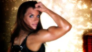 muscle milf flexing her biceps
