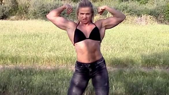 muscle dominatrix madam mysteria flexing biceps