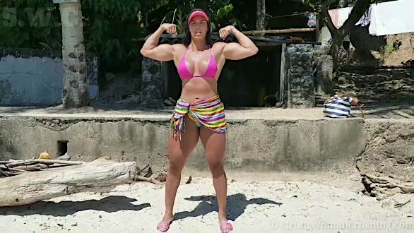 hot female muscle flex at the beach