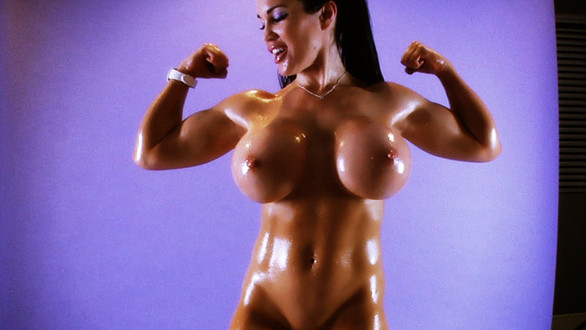 Amazing biceps on the beautiful and busty Samantha Kelly.