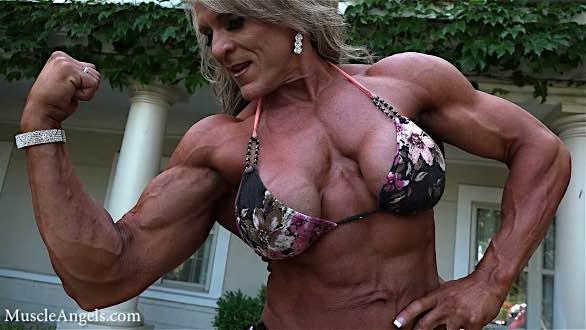 IFBB pro Angela Rayburn flexing biceps contest shape