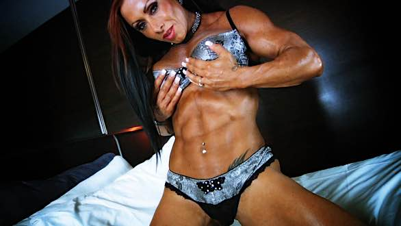 Monica Martin showing her abs
