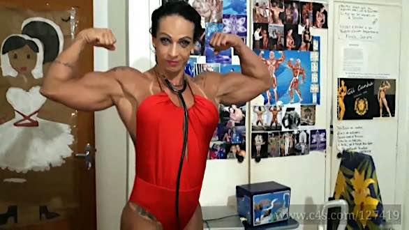 female bodybuilder Gil Cunha flexing her big biceps