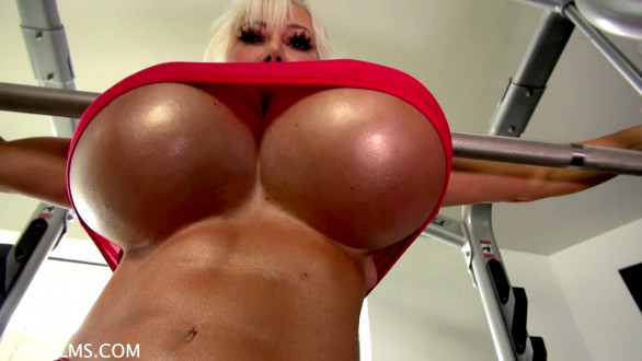 muscle MILF with huge fake tits