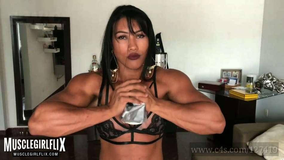 Female Bodybuilder Alessandra Alvez crushing metallic pan