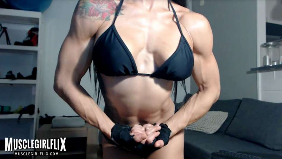 girl with muscle on webcam flexing arms and pecs