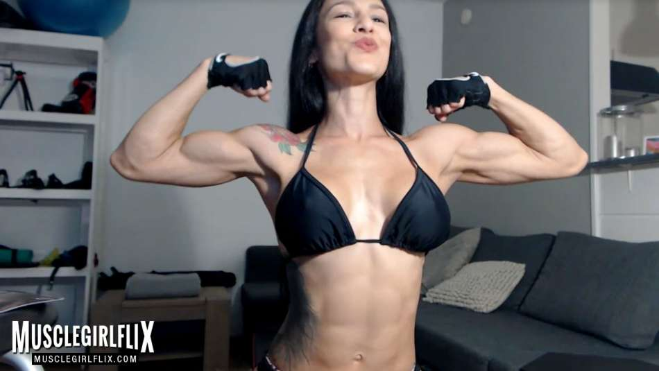 girls with biceps flexing on her webcam