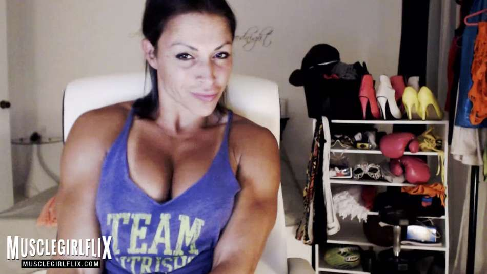 strong and sexy muscle girl pec flex