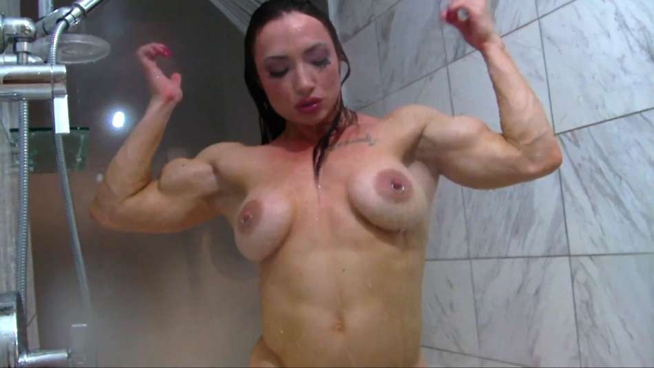 Brandi Mae topless hardbody flexing biceps