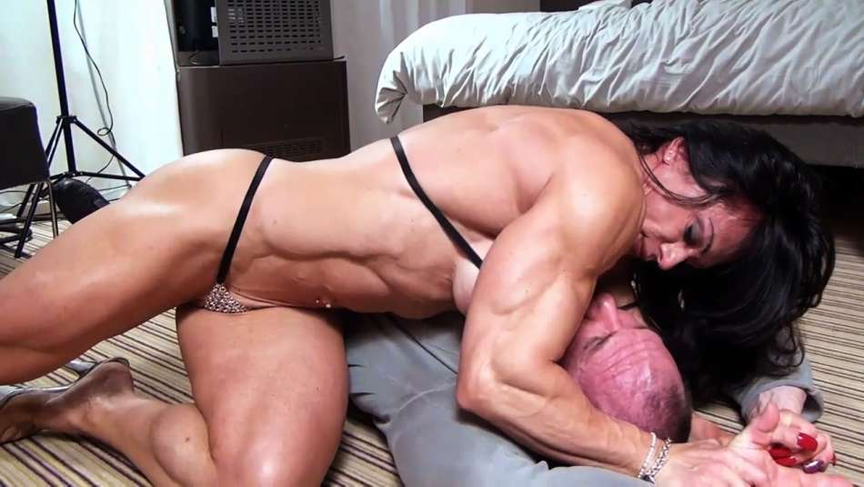 huge fbb Claudia Partenza wrestles a guy to the ground