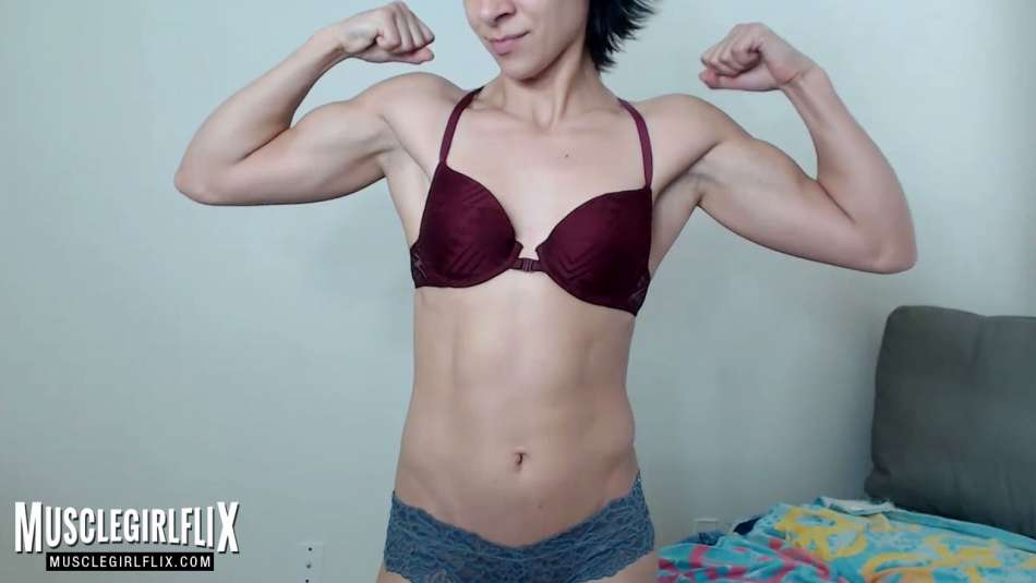 girl double bicep flex on webcam