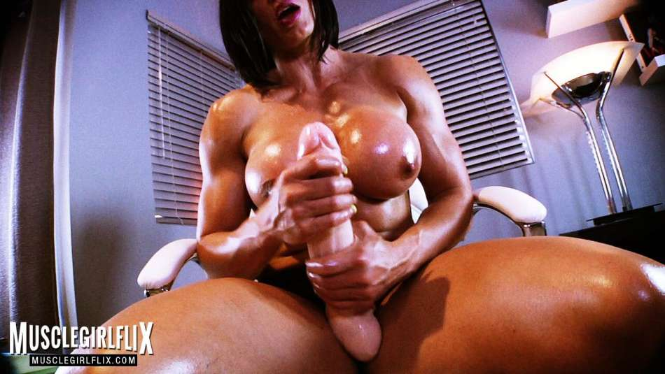 muscle babe stroking huge dildo so hard