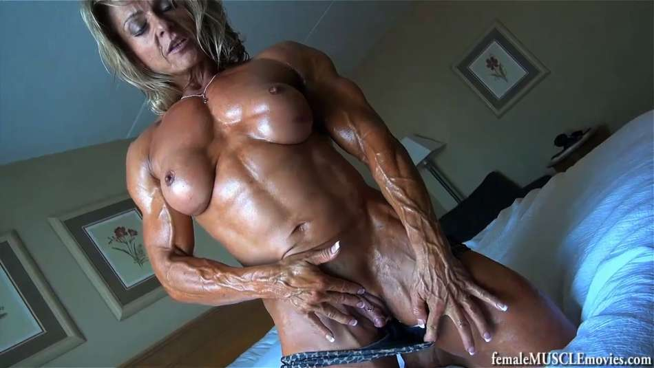 shredded and oiled female muscle
