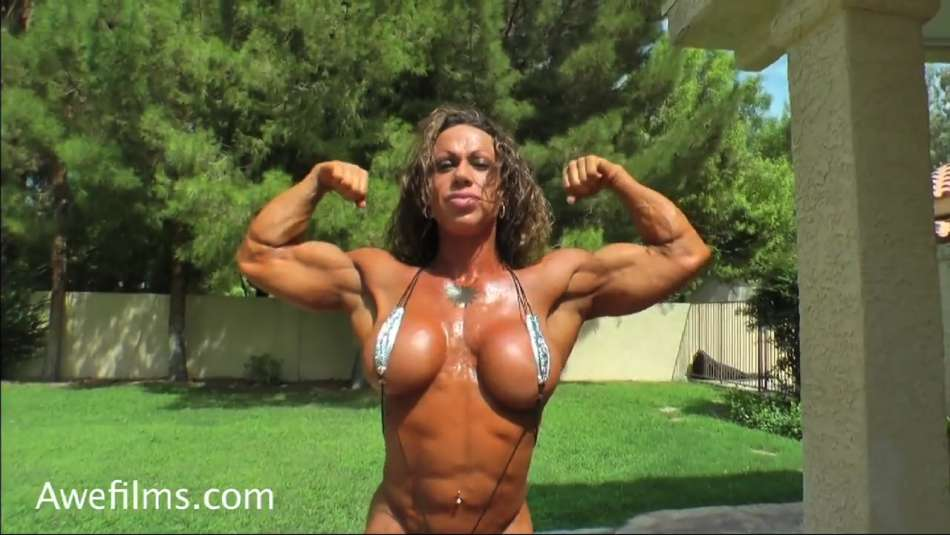 amazing female bodybuilder with fake tits