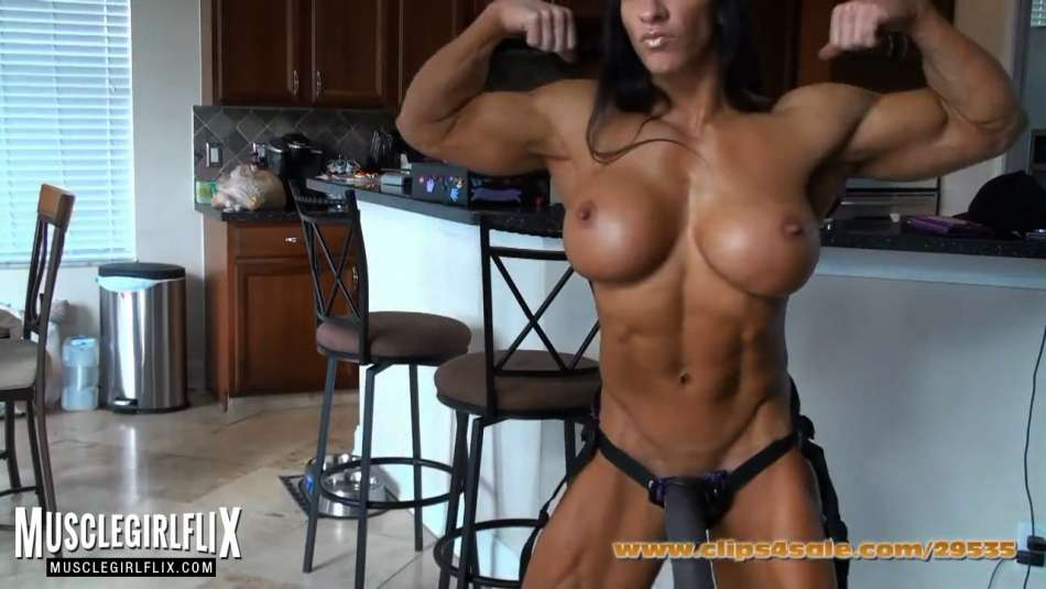 hot muscle chick flaunting big guns