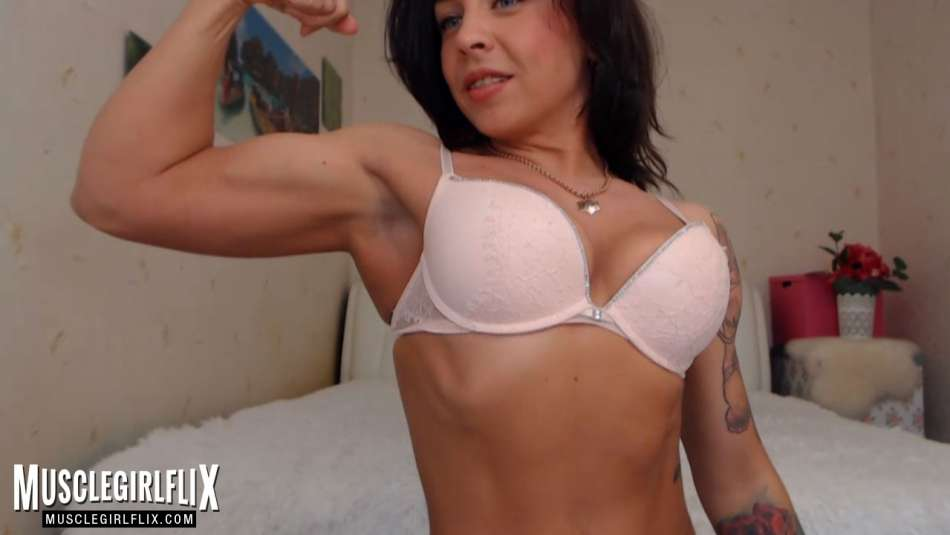 Muscle webcam girl Marietta flexing her bicep.
