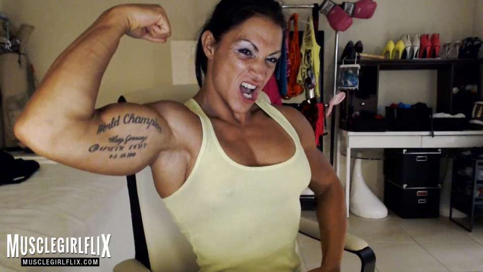 female bodybuidler on webcam flexing biceps