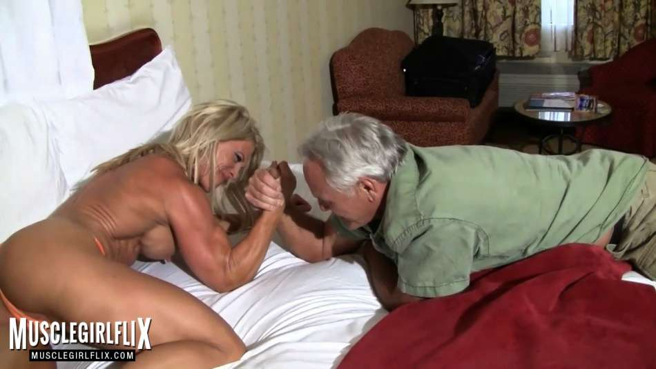 arm wrestling with muscular girl