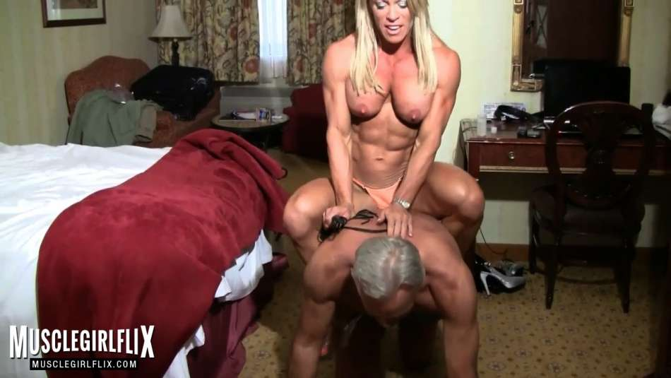muscle MILF rides guys back