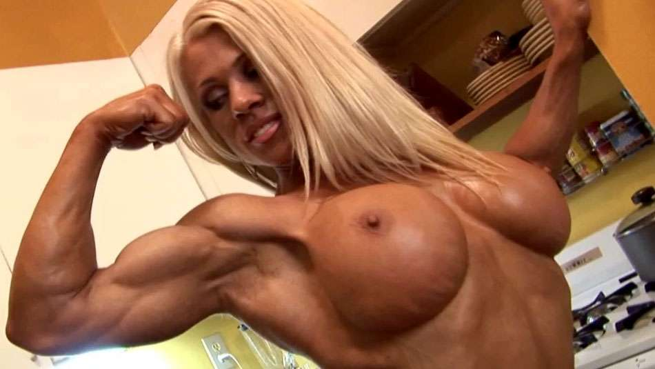 Melissa Dettwiller flexing her biceps and showing off big tits