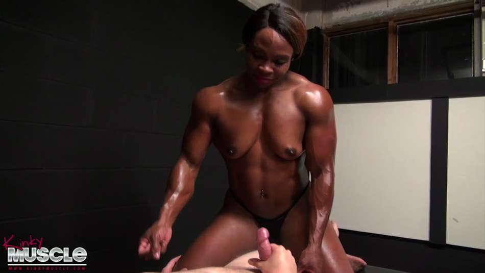 muscle girl on top ready to jerk a guy off