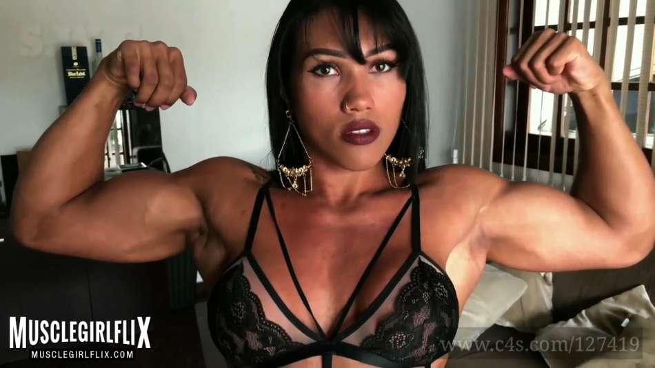 sexy brunette with big guns flex