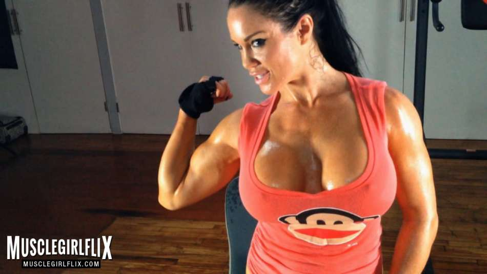 busty fitness model flexing bicep