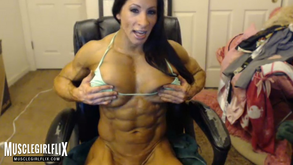 Angela Salvagno flexing her abs on cam
