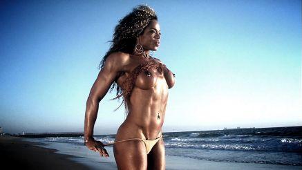 Amazing shot of Alexis Ellis topless on the beach.