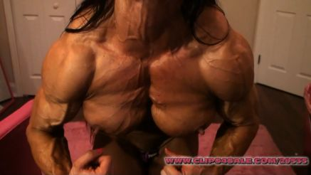 female bodybuilder Angela Salvagno super ripped pec flex