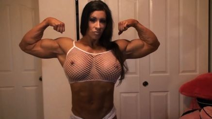 Angela Salvagno flexing her huge biceps