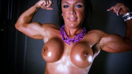 muscular woman bella topless and flexing biceps