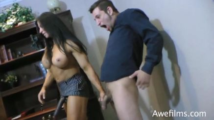 female bodybuilder dominatrix grabs a guys cock