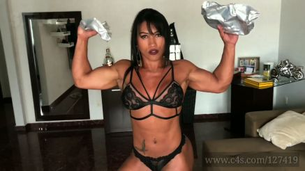Brazilian female bodybuilder beauty Alessandra Alves shows off strength
