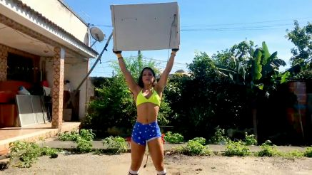 strong muscle woman destroys a washing machine