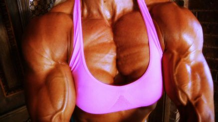 bodybuilder girl Brigita Brezovac huge muscle pec flex
