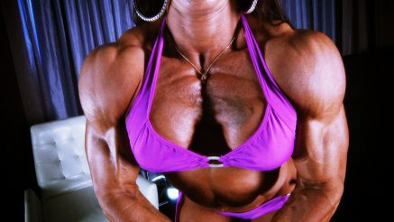 female bodybuilder carla rossi flexing her thick pecs
