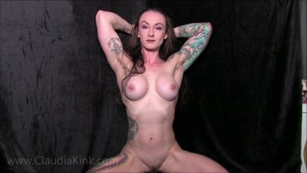 fit girl with tattoos flexing her muscles