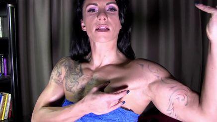 femdom bodybuilder flexing her thick pecs