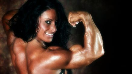 Debbie Bramwell flexing her thick biceps